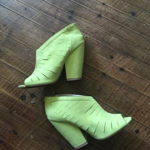 Neon yellow cutout peep toe heeled booties